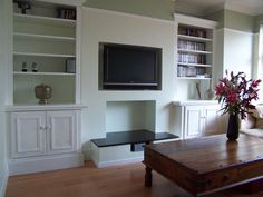 Basic set up of fireplace wall but with an actual fireplace and mantle. Also the shelves go all the way up to the ceiling.