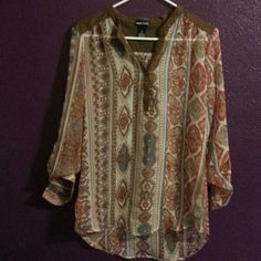 Blouse Brown cute blouse with unique patterns , bottom cream part is sheer, with roll up sleeves ,worn a couple times Wet Seal Tops Blouses