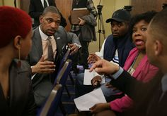Ferguson Commission Co-Chair Rev. Starsky Wilson, second from the left, talks with from left, Shirli... - AP Photo/St. Louis Post-Dispatch, David Carson