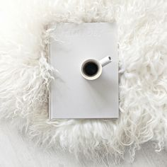 Sheepskin Rug from Milabert and Ceramic Espresso Cup from Serax Belgium.