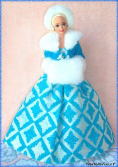 Barbie Winter Renaissance 1996. I have this doll! The White Fur Muff on her hands and Fur Headband are gorgeous!!!