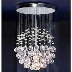 Chrome Ceiling Light with Suspended Clear Acrylic Droplets MiniSun http://www.amazon.co.uk/dp/B004VKA8TS/ref=cm_sw_r_pi_dp_Zh-Dwb0BB434K