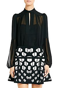 The Isolde in black is the season's must-have silk blouse.  http://on.dvf.com/13DEbJB