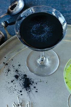 NYT Cooking: This dramatically dark drink's elegantly equal proportions are offset by the addition of a small amount of activated charcoal powder — an unusual (and, yes, edible) ingredient that has been making appearances on inventive cocktail menus in recent years. Here, it joins navy-strength gin, maraschino, Chartreuse, lemon juice and Brennivín — a bracing Icelandic schnapps — in beautiful balance. Sour Cocktail, Cocktail Garnish, Cocktail Menu, Champagne Cocktail, Mezcal Cocktails, Easy Cocktails, Classic Cocktails, Drinks Alcohol Recipes, Alcoholic Drinks