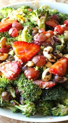 Strawberry Balsamic Poppyseed Broccoli Salad ~ Broccoli, bacon, salty feta, fresh strawberries, juicy grapes, and cashews covered in a creamy balsamic poppyseed dressing. Quick, easy, and makes great leftovers.