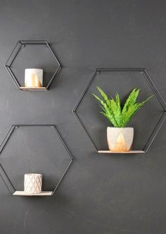 Set of 3 Industrial Hexagonal Wall Shelves Metal and Wood Industrial Shelving Units Sold in a set of three. Perfect for creating artistic wall displays. Shelf dimensions Large = x x Medium = x x Small = x x Black wire frame with wooden