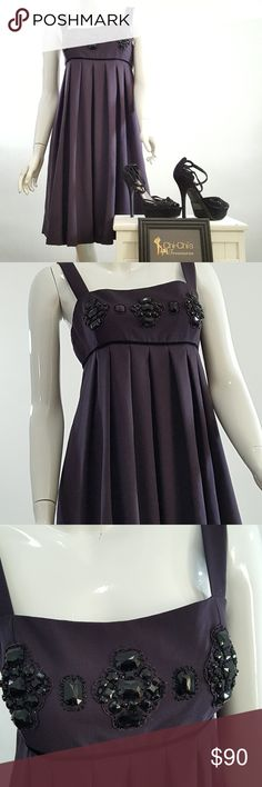 TAHARI PLEATED COCKTAIL DRESS SZ 10 Tahari pleated dress adorned with black Stones across the top. Size 10. Dark Plum color with lining. Materials polyester/wool/spandex (slight stretch). Length  37 in, armpit to armpit 17.5 in. Measurements are approximate. (C56-C3) Tahari Dresses Midi
