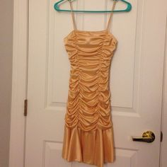 Gold ruched dress Size small gold dress with ruched design. Spaghetti straps. Worn once.                                      only offers made through the offer button will be considered Dresses