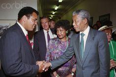 Nelson Mandela Shaking Hands with Muhammad Ali  Photographer: David Turnley