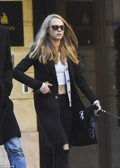 Sporty spice: The 23-year-old supermodel displayed her usual example of sports luxe in huge trainers and a skimpy crop top, while her older sibling, 29, oozed boho glamour in a suede coat