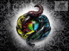 The Arcus II Kraken brooch - multi and black polymer clay tentacles with rainbow cat's glass eye - Fantasy Cthulhu monster jewellery brooch