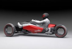 Take a Formula One driving position, three wheels, a high-power 550cc v-twin engine designed for motocross, put an additional electric motor into each wheel, an