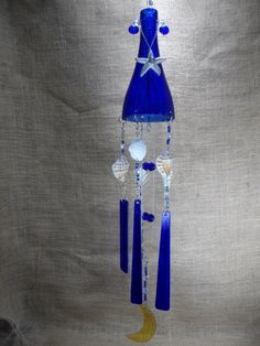 Stained glass wine bottle wind chime, blue bottle with blue and yellow glass, sea shells and a starfish. This one is called Midnight in Cozumel . At jitter Beans in Mineral Wells, Texas