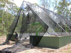 aviary netting | Erecting the netting to the 8.5 meter high aviary . Note the sidewalls ...