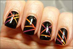 http://www.sugar-nails.com/2012/04/striping-tape-fun.html