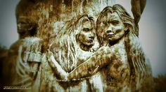 An artistic relief of two women. This is engraved on a tall statue that is near the beach in Playa Del Carmen.