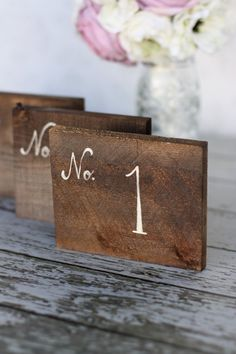 If we do table numbers, I like these. How To Find The Perfect Rustic Wedding Table Numbers Wedding Planning On A Budget, Wedding Decorations On A Budget, Diy On A Budget, Wedding Centerpieces, Budget Wedding, Rustic Centerpieces, Event Planning, Wedding Arrangements, Centerpiece Ideas