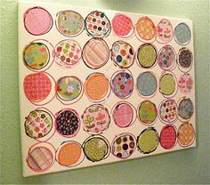 coordinating scrap book paper cut into circles, mod-podged on to the canvas, then roughly outlined in different colors of slick paint
