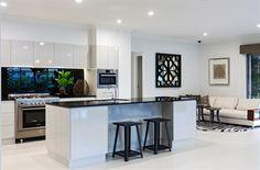 Jetblack caesarstone tops, white cabinetry