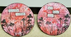 A pair of Artist Trading Coins:  Distress ink and stamped backgrounds, flower stamp and Tim Holtz Chitchat sentiments