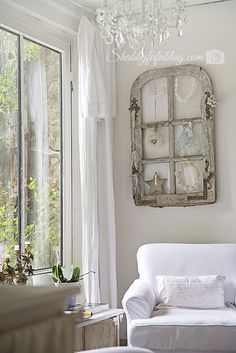 An Exquisite French Country Home Tour. A great way to use an old window frame...as a way to display collectibles.