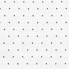 """Lawn. Robert Kaufman Dobby Dot in White (57"""" wide). Perfect for making crisp tops, dresses and skirts."""