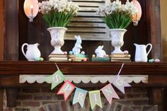Fireplace mantel Easter decoratiing. The white letters are painted on burlap with a happy-colored felt backing. This would be so easy to make! The sweet white shabby bunnies were also from Target.