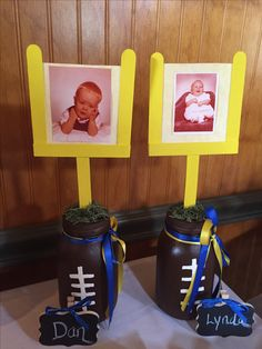 Painted large Mason Jars, attached lid, put slit on it, stuck painted sticks from craft store into it(formed goal post) put Baby pictures of my daughter & her husband - Used for Sports Themed Baby Shower