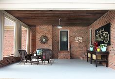 outdoor sitting area with indoor touches Covered Patio Makeover // 7thhouseontheleft.com