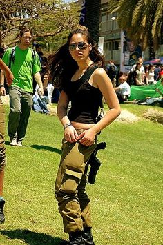 Israeli women can go for a walk in the park, unaccompanied and dressed in pants, a la the attractive, off-duty IDF female soldier pictured at right.