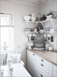 come up with some shelving plan for under the cabinets?