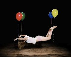 Floating with balloons. Artwork by Sam Taylor-Wood.