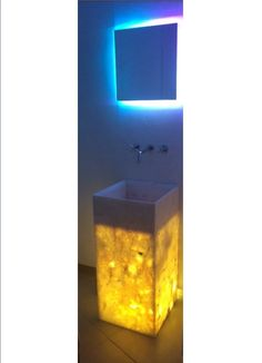 """From Beyond Decoration Studio Collection the beloved pieces """"Spring"""", a bathroom sink from Greek marble with light and """"North"""" an art sconce from mirror and lightning created in interplay with artist @nikosmaros  #interiordesign #elenaarsenoglou #beyonddecoration #contemporary #art #nikosmaros #luxury #modern #bathroom #sink #greek #marble #mirror #lighting #sconce #fengshui #home #hotel #villa"""
