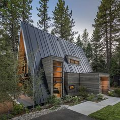 Situated among the soaring pine trees of Tahoe City, California, this sleek, contemporary A-frame features cool wood-sided window popouts and massive picture windows. Its seamed roof forms a barcode to the nearby Olympic site Squaw Valley. A Frame House Plans, A Frame Cabin, Wood Frame House, Tiny House Cabin, Cabin Homes, Tiny Houses, Casa Loft, Cabin In The Woods, Forest House