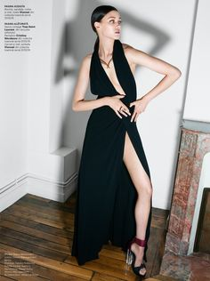 "Diana Moldovan models evening wear in ""Le Chat Noir"" for Harper's Bazaar captured by Dan Beleiu."