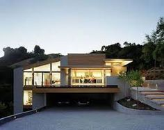 Image result for stilt house on sloping section with garage