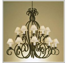 """10134-60-N  TWENTY LIGHT TWO TIER IRON CHANDELIER FINISH SHOWN: PUEBLO SHADE: 3X8X4 1/2 WITH WHITE WAX CANDLE MAXIMUM WATTAGE: 1200 CANDELABRA BASE SOCKETS HT 56"""" W 60"""" APPROX. WT: 90 LBS. REQUIRES REINFORCED J-BOX"""