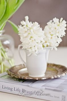 Fragrant White Hyacinth beautifully displayed in a milky pitcher atop a vintage tray