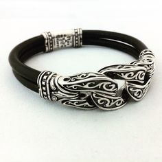 Leather and sterling silver bracelet by geoartshop