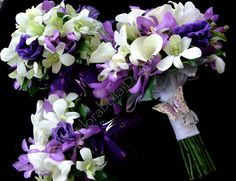 White and Purple Wedding Bouquets.. A darker purple but I love these!!