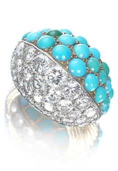 *A turquoise and diamond cocktail ring, by Cartier, circa 1960 Of bombé design, pavé-set on one side with cabochon turquoise and on the other with brilliant-cut diamonds, over a tapering reeded shank, signed Cartier Paris, French assay marks, diamonds approximately 4.00 carats total, Cartier ring box.