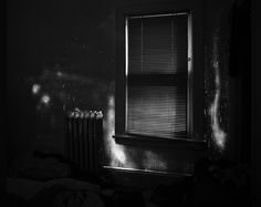 Angela Strassheim - Evidence  Evidence is a group of photographs taken at homes where familial homicides have occurred. The black and white images are long exposures – from ten minutes to one hour – with minimal ambient night light pouring in from the crevices of windows and doors, capturing the physical presence of blood as a lurid glow.
