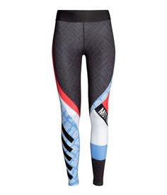 Dark gray/patterned. Sports tights in fast-drying, functional fabric with wide elastication at waist.