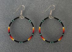 Made by Rita, Mi& Indian of the Gesgapegiag Mi& tribe. Turquoise and Black Beaded Silver Hoop Earrings. Earring Hoop is in Black with Turquoise color with Sunburst Colors in colors black, Red, orange, yellow and white. Bar Stud Earrings, Moon Earrings, Unique Earrings, Silver Hoop Earrings, Bead Earrings, Crystal Earrings, Turquoise Earrings, Earrings Online, Silver Ring