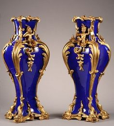 A pair of Louis XV style ormolu mounted blue porcelain vases