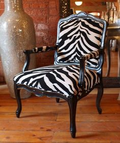 zebra chair - I took hubby's grandmother's antique chair similar to this and had it reupholstered like this..WAY COOL way to take an heirloom and update it!