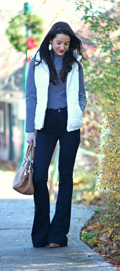 Cute and preppy fall outfit idea with J Brand dark wash flare jeans, Old Navy white puffer vest, and LL Bean striped turtleneck
