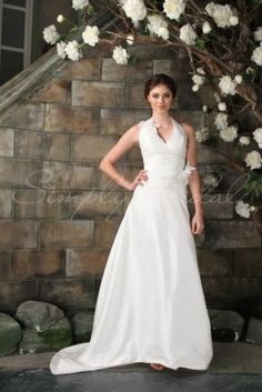 Wedding Dress by SimplyBridal. The Sakura is an A-line gown with a sexy  halter neckline, featuring a delicate flower applique. The fitted bodice is accentuated with beaded lace applique. This woud be perfect for an indoor weddings, or outdoor garden wedding.. USD $251.99