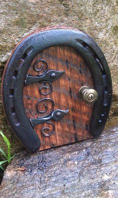 I make these doors from used horse shoes, hand forged hardware, and repurposed items. 5 inches tall and 4 inches wide. All your wee folk will love them for fairy garden Magical fairy door Fairy Garden Houses, Diy Garden, Garden Projects, Garden Ideas, Fairy Gardens, Gnome Garden, Garden Art, Art Projects, Fairy Garden Doors
