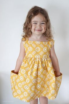 Sewing Dresses The Sally Dress pdf pattern from Very Shannon. - A vintage inspired dress with modern flair! The Sally Dress features a fully lined bodice, a square neckline with no closures, sleeveless Baby Girl Dress Patterns, Baby Clothes Patterns, Little Girl Dresses, Girls Dresses, Toddler Dress, Baby Dress, Toddler Girl, Baby Girl Fashion, Fashion Kids